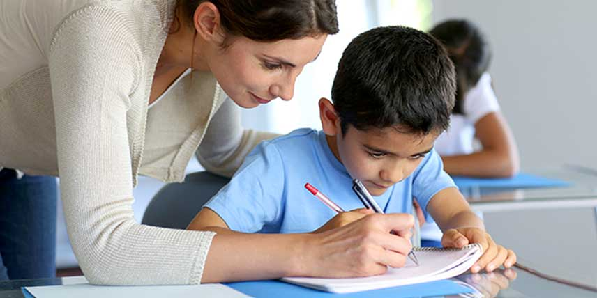 A teacher giving personalised feedback to a child